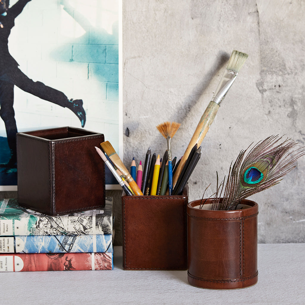 Different styles of leather pen pots