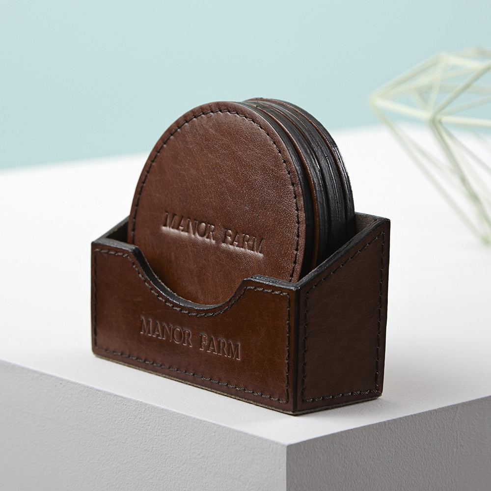 Round coasters in an embossed holder