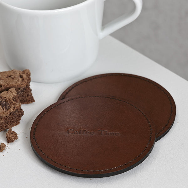Round leather coaster with coffee time embossed