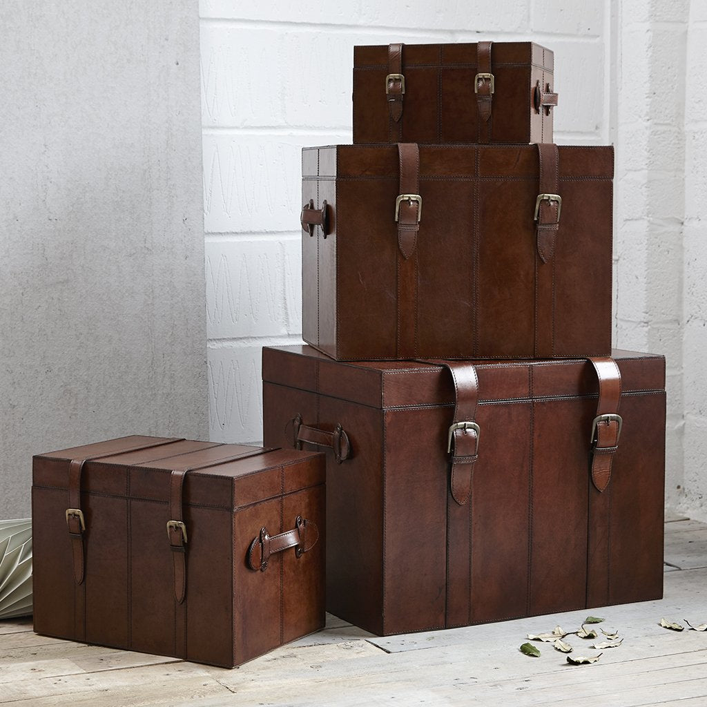 Set of four leather trunks