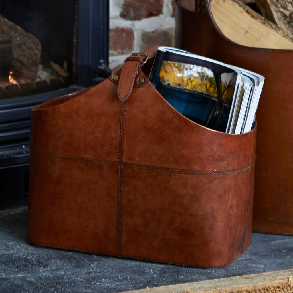 buckled magazine basket next to a fire place