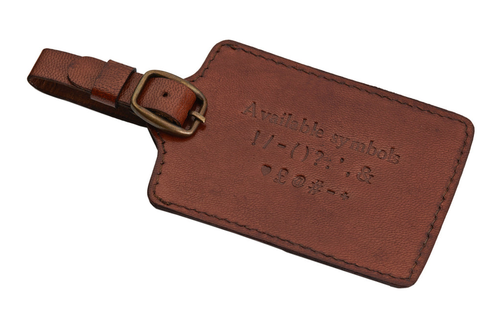 Embossed luggage tag on three lines