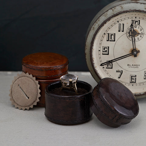 Tiny leather ring box with ring insert