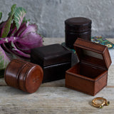 Tiny leather boxes, round and oblong