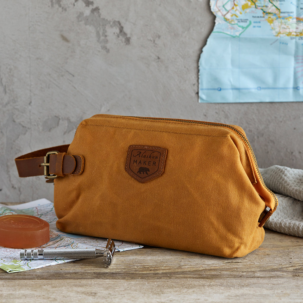 closed toiletry bag in mustard canvas