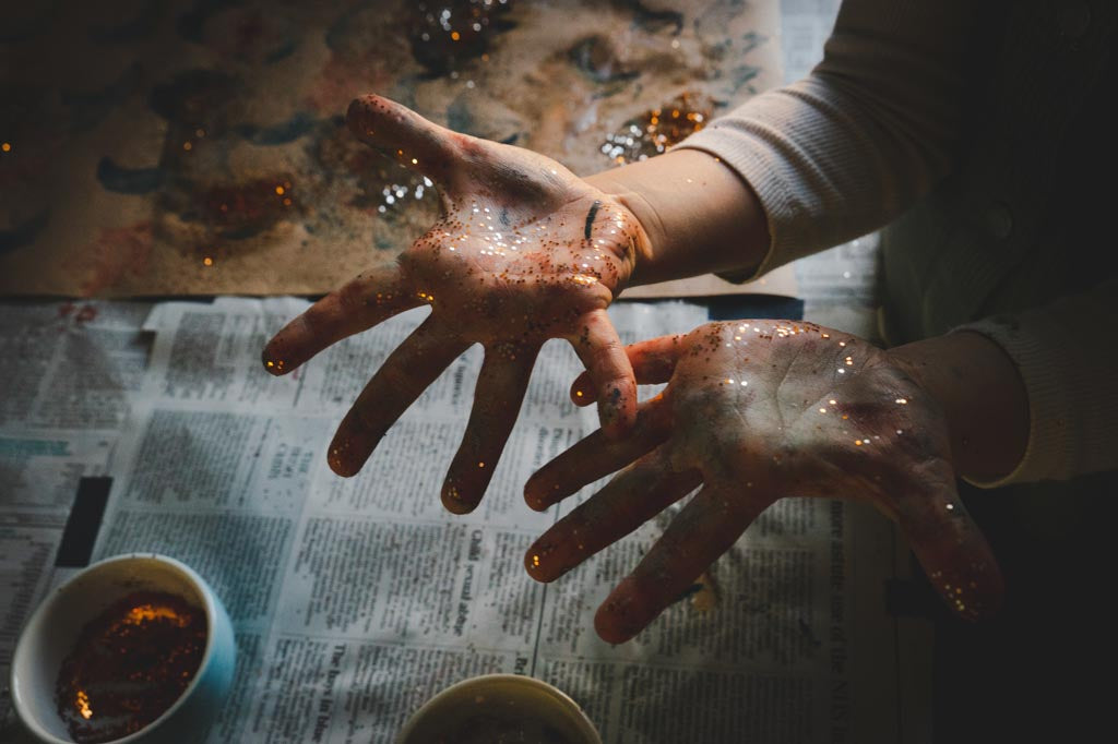 Messy hands, covered in glitter