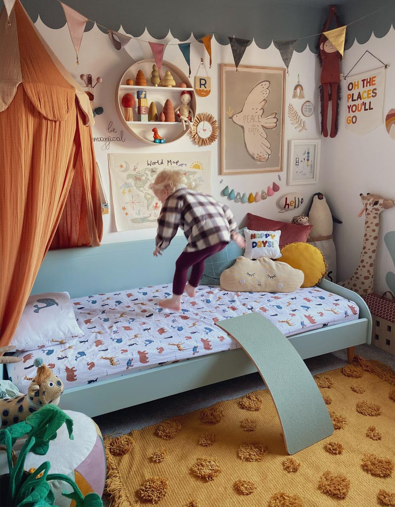 A boy jumping on a bed - a great way to improve balance