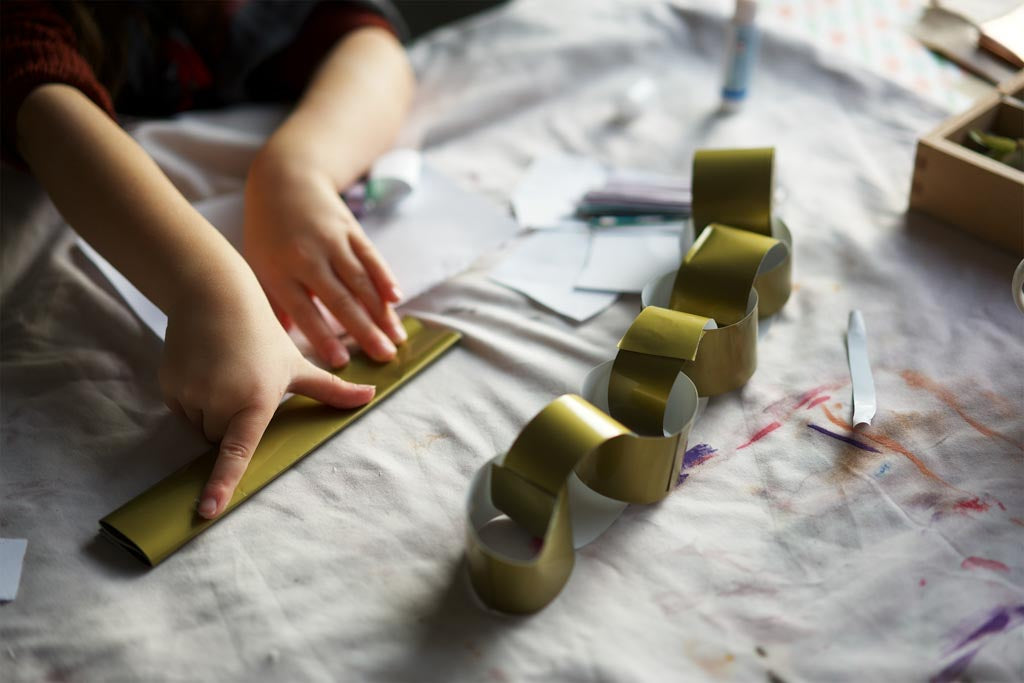 Child making a paper chain