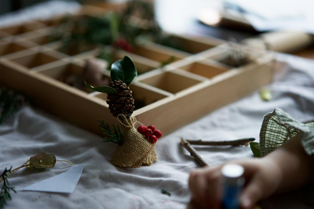 Making pine cones into Christmas tree ornaments