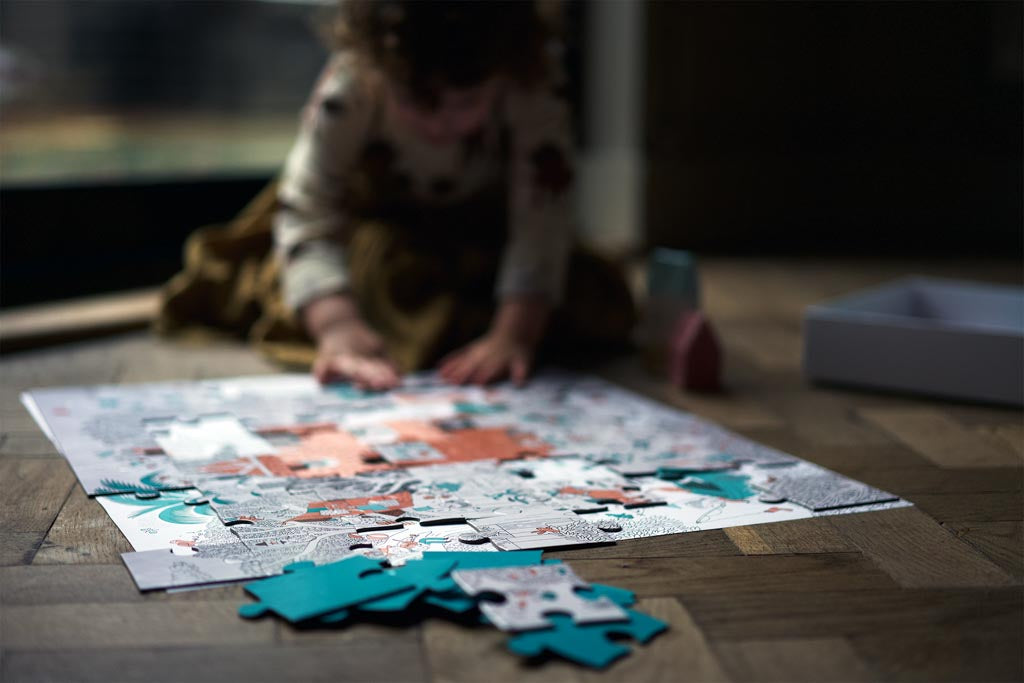 A child completing a puzzle