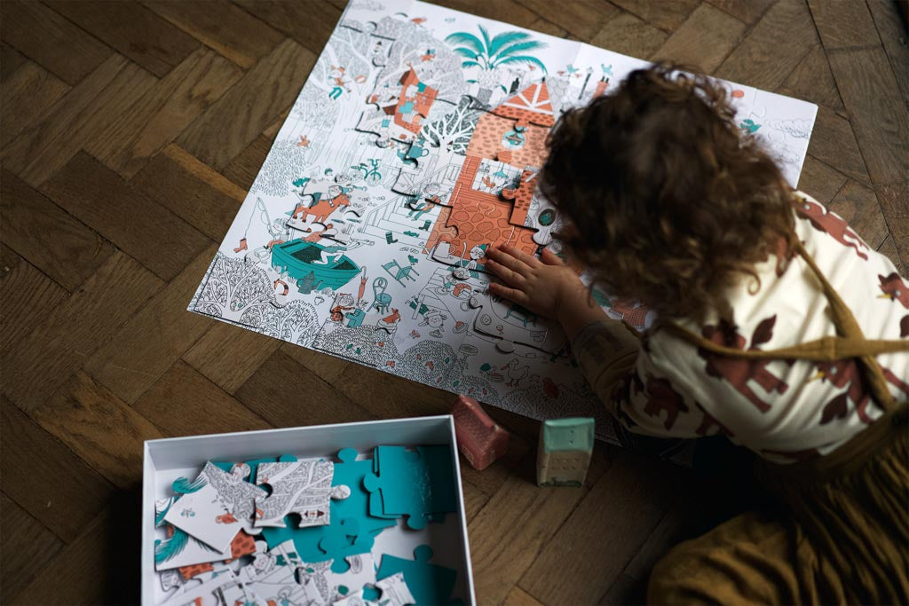 Picture of preschooler completing a 100-piece puzzle