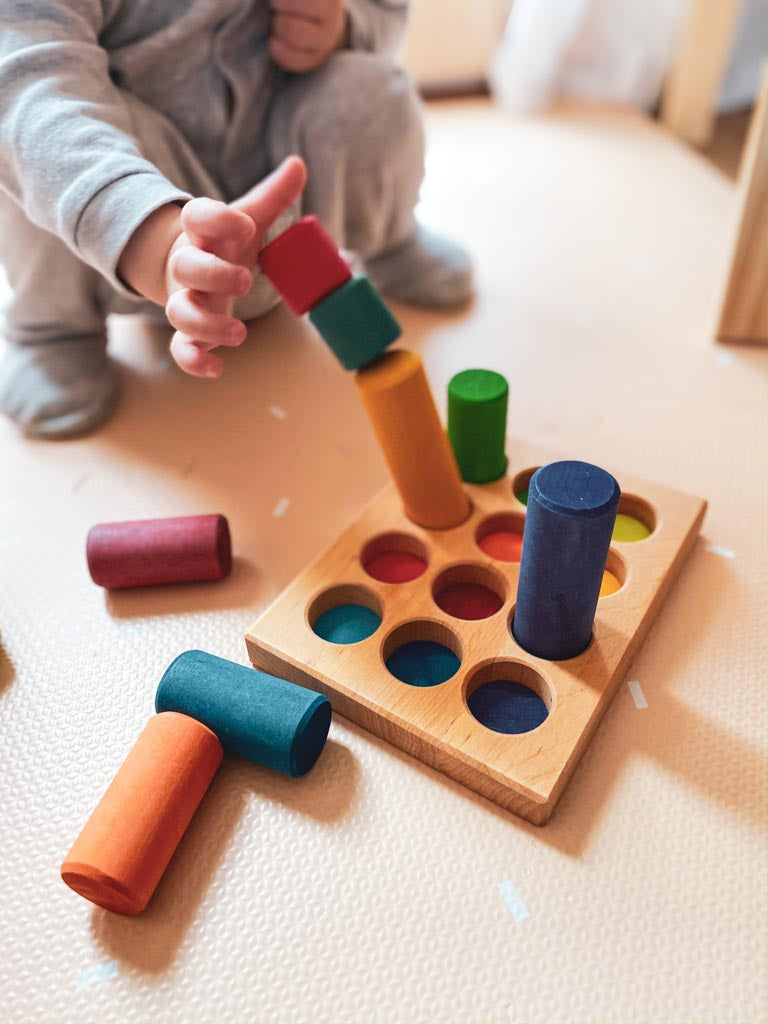 A child playing with a shape sorter