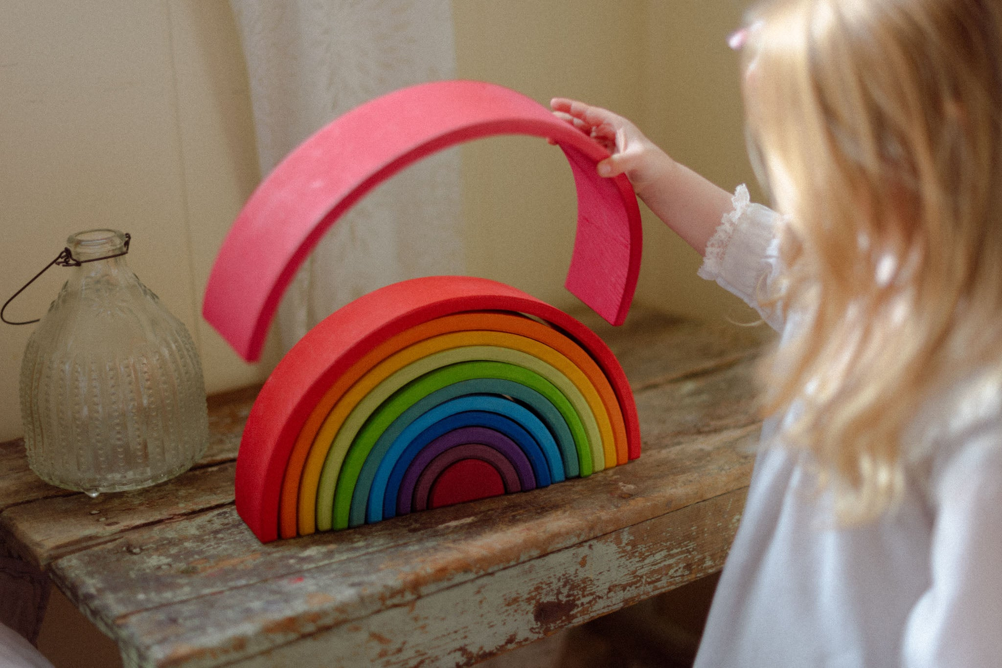 Choose simpler toys - Grimm's large rainbow