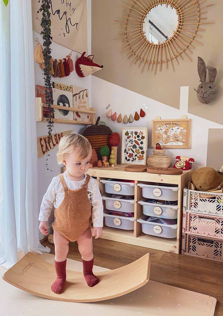 A toddler with a Wobbel starter board