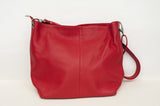 Soft grained leather bag with strap