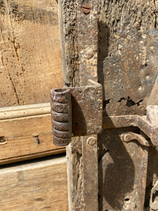 A large sculptural 17th century lock mounted on an oak board