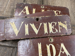 A set of 4 Victorian painted farmhouse shippon cattle name signs