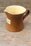 Slipware cream jug by Isaac Button of Halifax