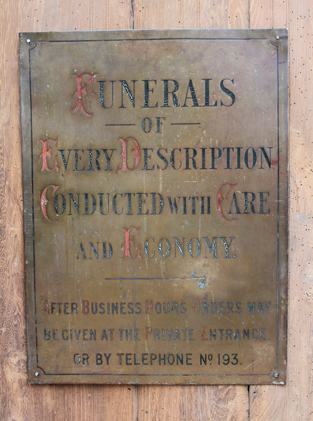 Early 20th brass funeral sign