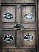 A set of five toleware country house servant's bell signs