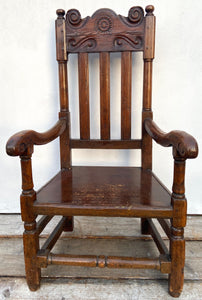 A large 17th c Scottish open arm chair from Braemar Castle
