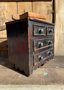A diminutive provincial chest of drawers c. 1850