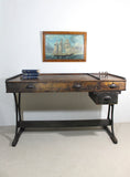 A large 19th century printer's table on a cast iron base
