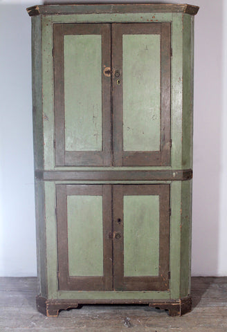 Early 19th century floor standing corner cupboard in original paint