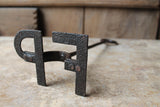 "Early 20th century branding iron initials ""FP"""