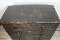 A George III chest of drawers of small proportions in original condition