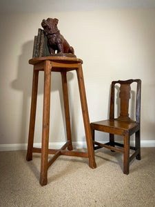 A large scale 19th century sculptor's stand with original grain effect paint finish