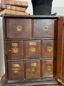 A delightful 19th century Welsh spice cabinet in the original finish