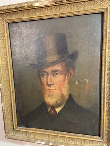 A mid 19th century portrait of a gentleman in a top hat