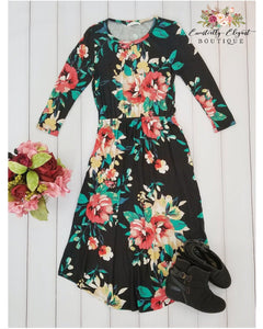 Dear To Me Floral Print Midi Dress with 3/4 Sleeves and Pockets in Black - Essentially Elegant