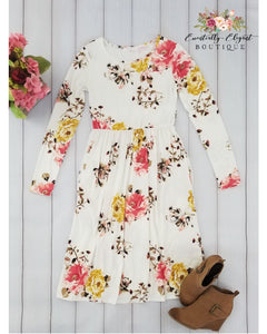 Ageless Bliss Floral Print Midi Dress with Long Sleeves and Pockets in Ivory - Essentially Elegant