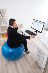 woman sitting exercise ball