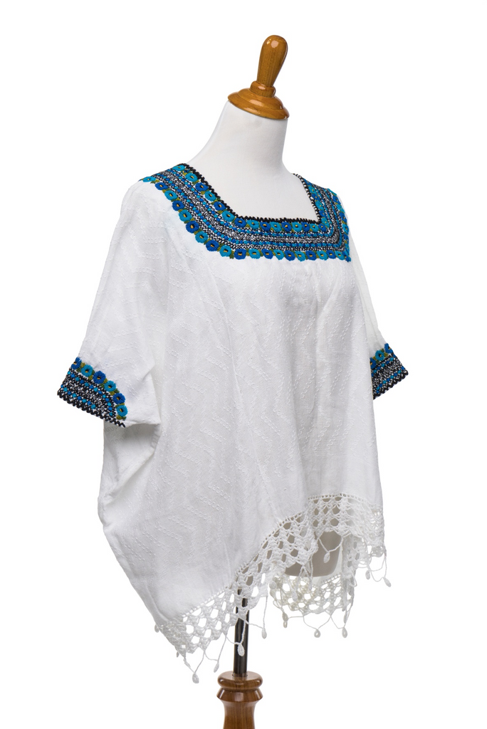 hand embroidered Guatemalan blouse white with turquoise and green and black embroidery on neck and arms, global chic for the modern woman