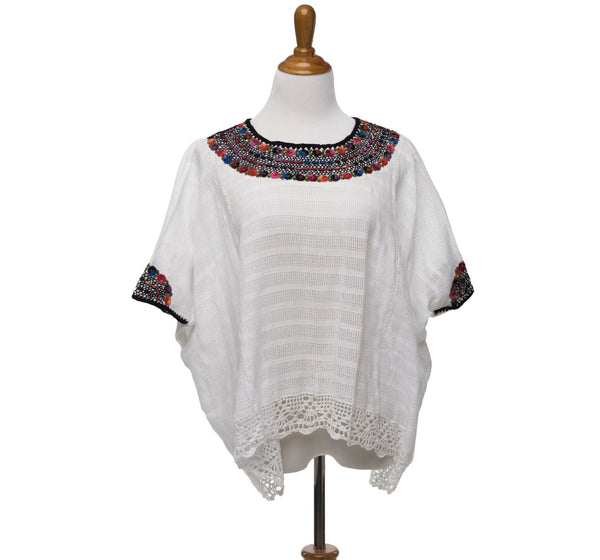 hand embroidered Guatemalan blouse multi color embroidery detailed bottom edge