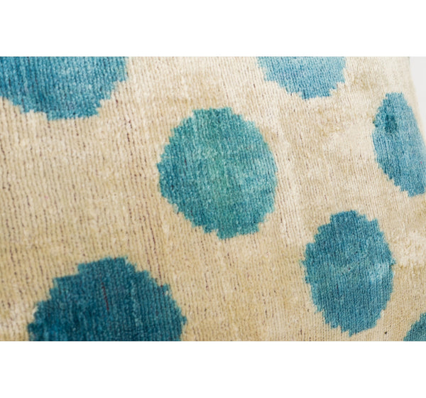 silk velvet ikat pillow in aqua blue and cream dot pattern. chic and modern yet made from a centuries old textile tradition.