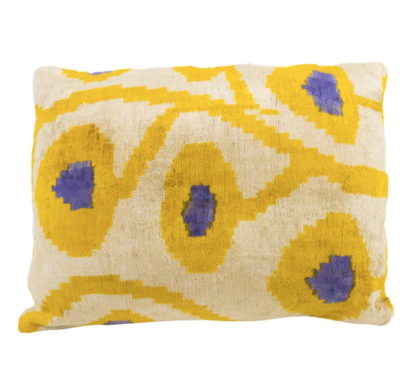 silk velvet ikat pillow in yellow, white and a splash of purple. Modern abstract floral pattern chic and elegant decorative pillow