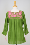 hand-embroidered Mexican blouse. Spring green with pink embroidery. Three quarter length sleeves tunic style