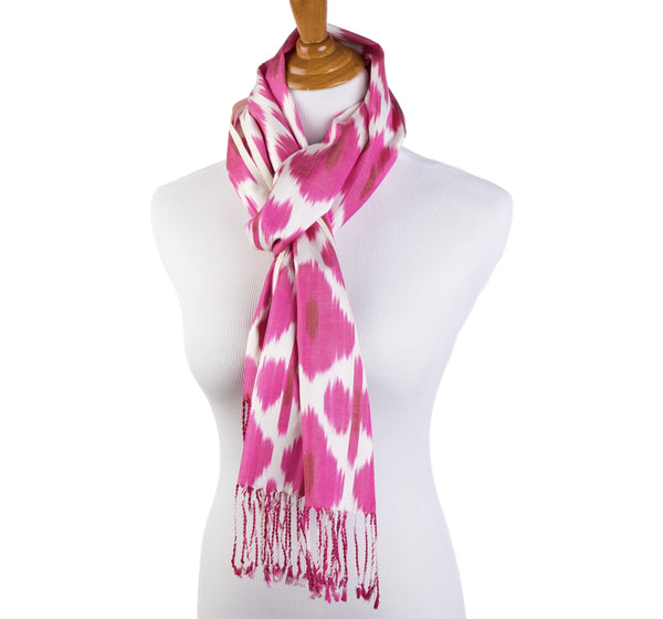 silk ikat scarf in gorgeous shades of pink hand dyed and hand loomed in uzbekistan perfect with jeans or a little black dress