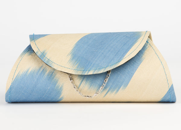 silk ikat clutch, hard shell with detachable chain/ strap in cream and light blue ikat pattern