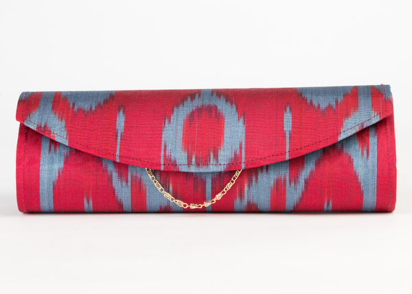 silk ikat clutch, hard shell with detachable chain/ strap in red and blue ikat pattern