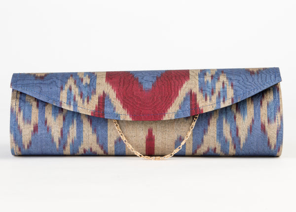 silk ikat clutch, hard shell with detachable chain/ strap in French blue and aubergine ikat pattern