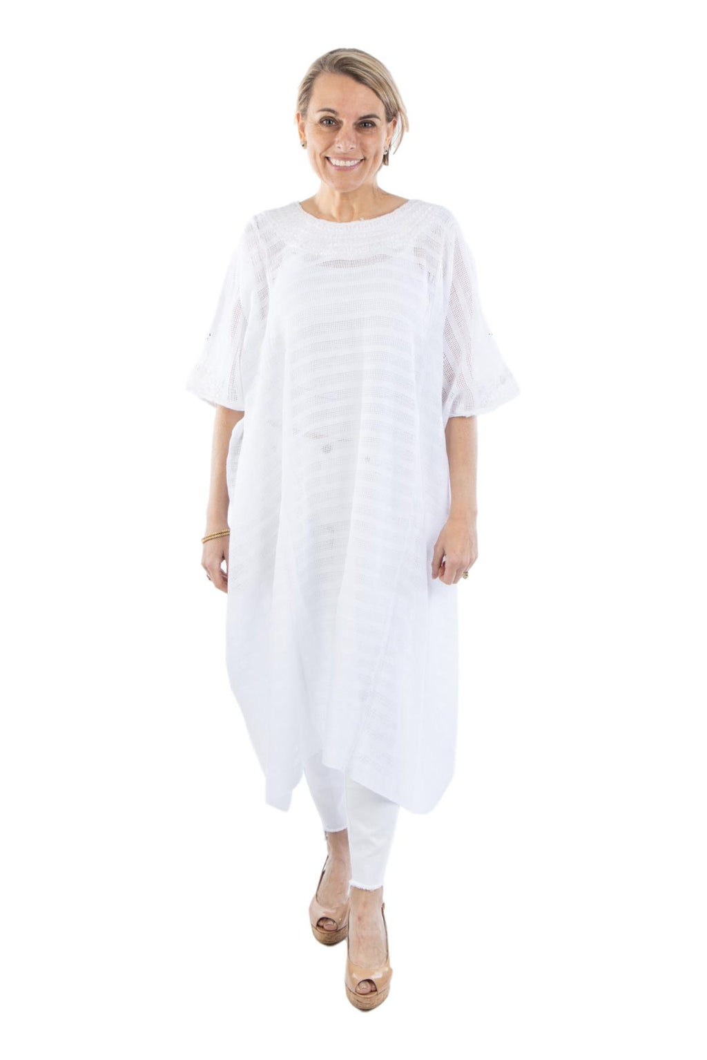 white gauzy caftan hand embroidered in Guatemala. Chic, bohemian style, fair trade, ethically made, elegant forever piece.
