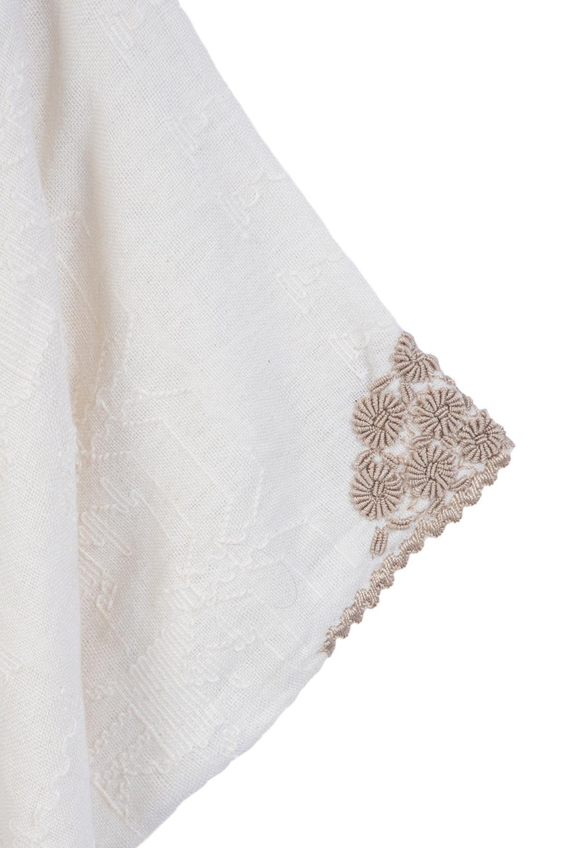 Hand-loomed and hand-embroidered tunic ivory blouse sleeve detail