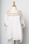 Chic hand embroidered blouse from Guatemala. White cotton with neutral taupe embroidery at neck and sleeves. Perfect as a tunic with jeans/ shorts or pants. Also great as a cover-up at the beach or pool.