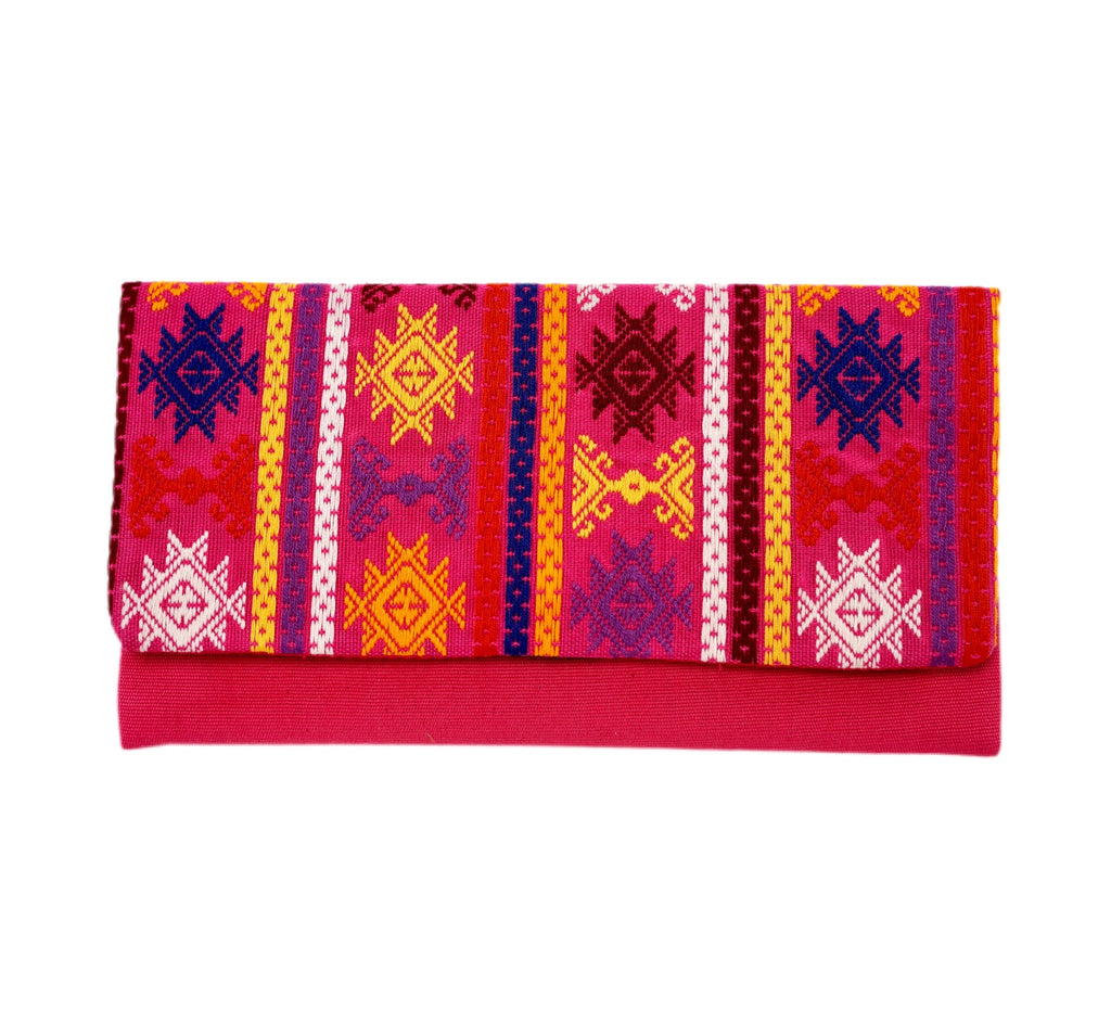 Vibrant pink and multi-colored hand-embroidered clutch from Guatemala. Made by women-weavers. Fully lined, with an interior zippered pocket.