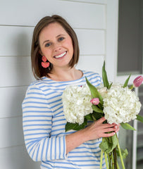 Woman holding hydrangea and tulip bouquet, welcome to Carolina Dandy